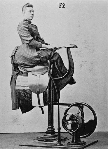 Lady learning to ride side saddle